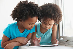 Young Girls on Tablet