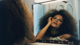 Woman with Afro in Mirror