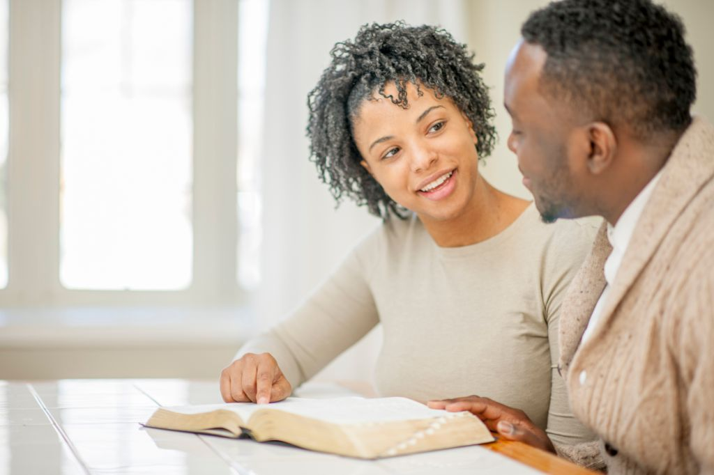 Husband and Wife Studying the Bible Together