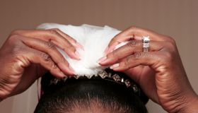 Detail of African-American bride putting on her tiara