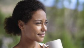 Cropped shot of a young woman enjoying a cup of coffee