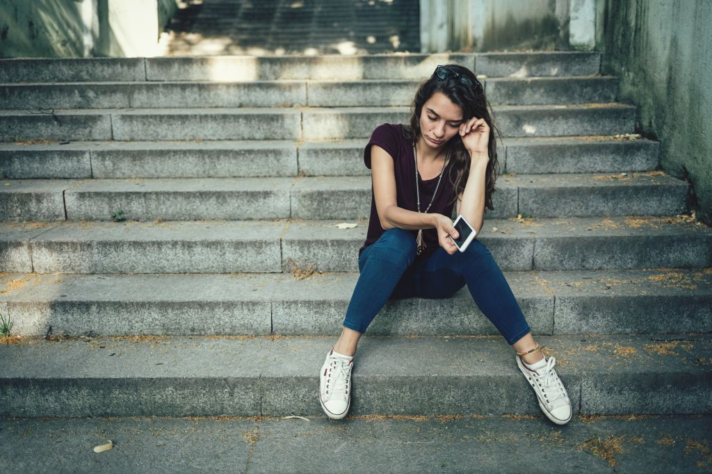 Girl crying on stairs