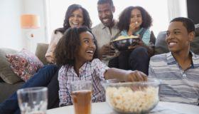 Black Family Sitting Together