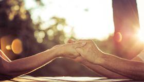 Senior couple on park bench enjoying sunset