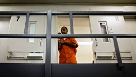 An inmate watches from his cell as DC Mayor Muriel Bowser tours DC Central Jail after announcing policy changes to support employment for inmates during and after incarceration in Washington...