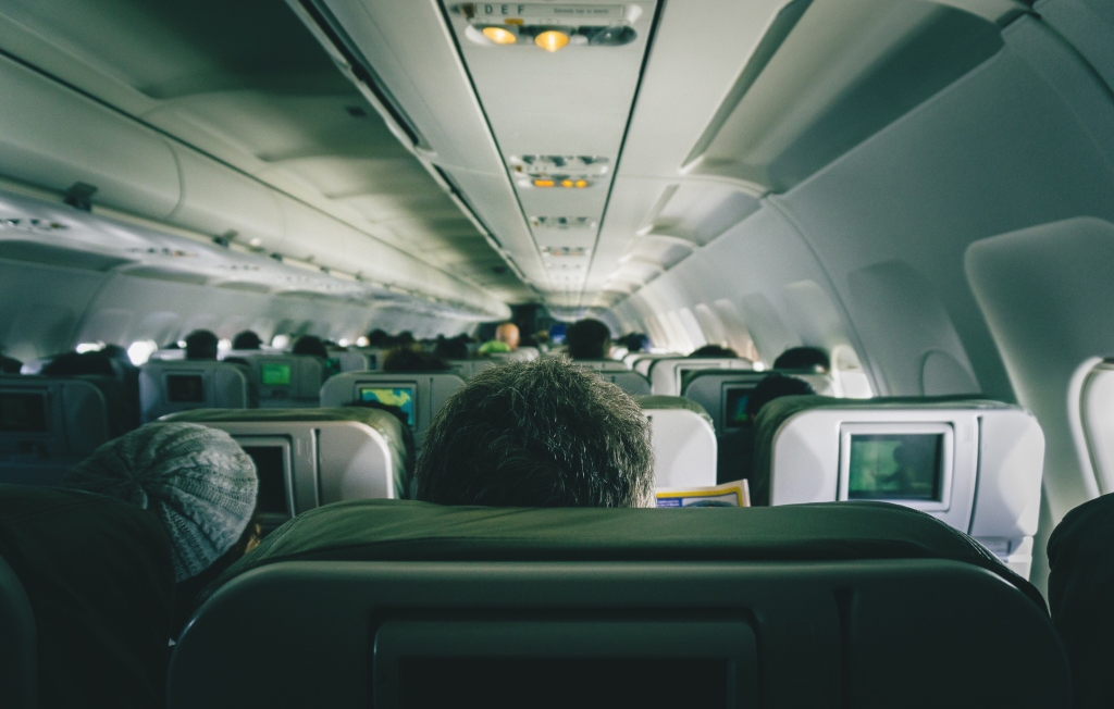Rear View Of People Sitting In Airplane