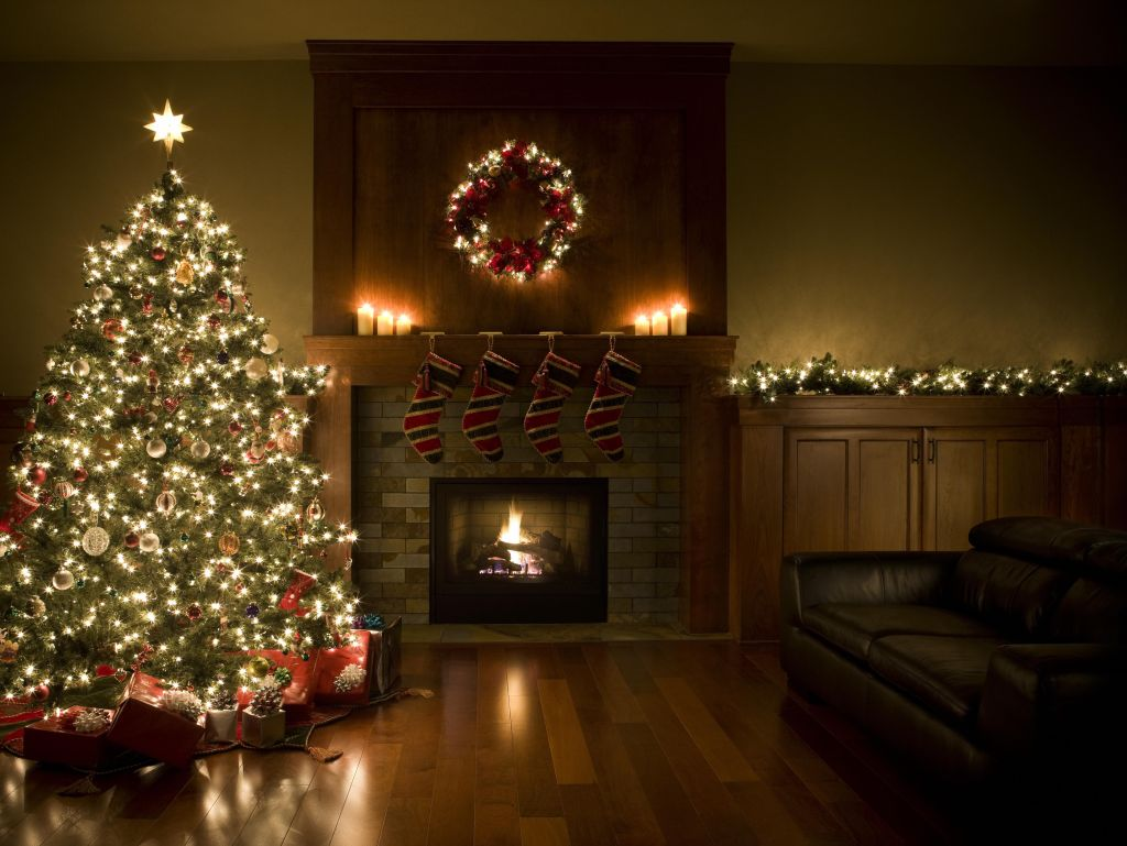 Adorned Christmas Tree, Wreath, and Garland Inside Living Room, Copyspace