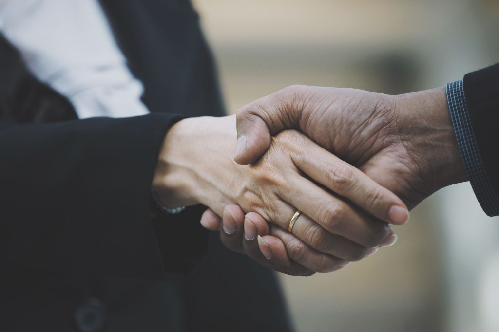 Close-Up Of People Doing Handshake
