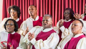 Mature black women and men singing in church choir