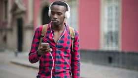 African teenager using mobile phone
