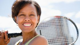 Black woman holding tennis racquet
