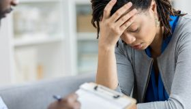 Counselor talks with depressed woman
