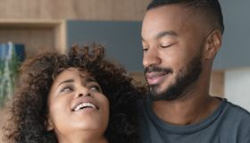 Happy African American couple at home