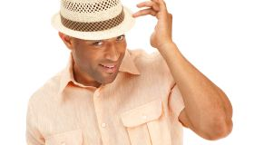 Sexy African American man showing off wearing a summer hat