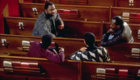 Young Men Talking With Pastor