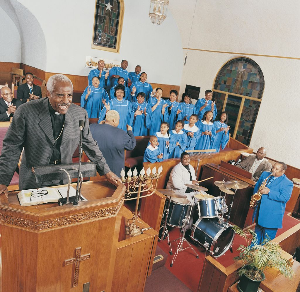 Gospel Choir and Band Playing at a Church Service With a Priest Standing on a Pulpit