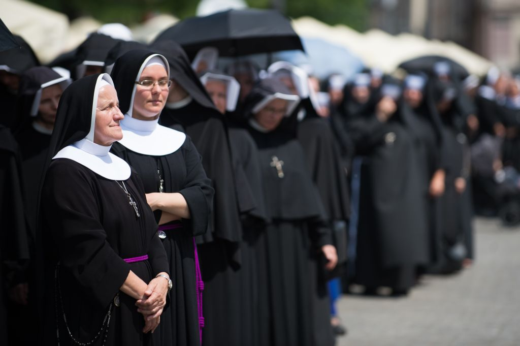 Nuns are seen during the Corpus Christi procession in Krakow...