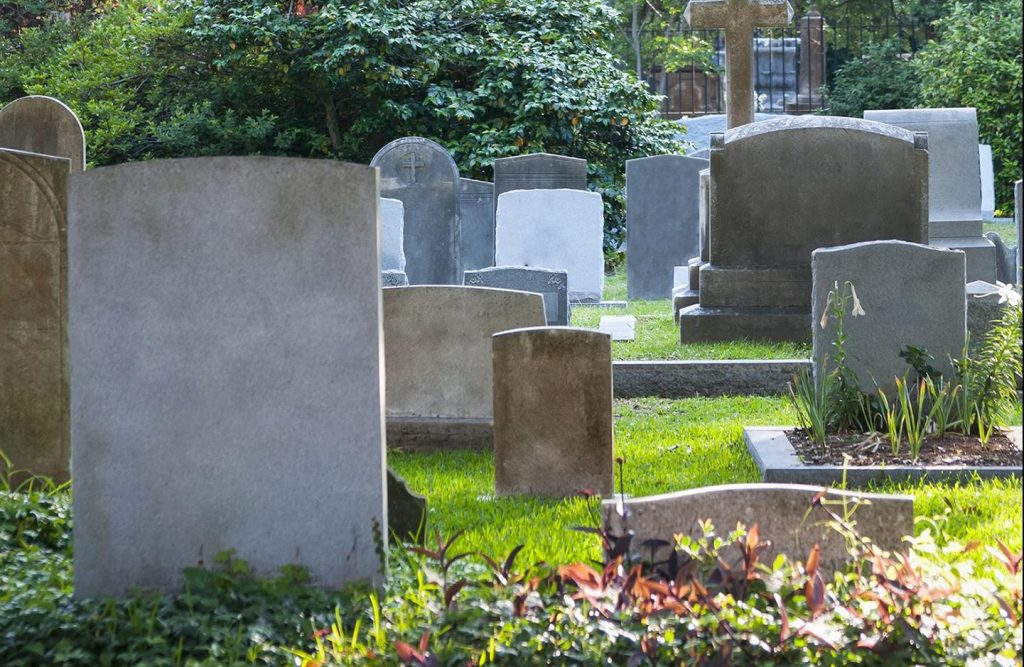 Headstones in beautiful cemetery with nature
