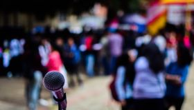 Close-Up Of Microphone Against Crowd During Music Concert