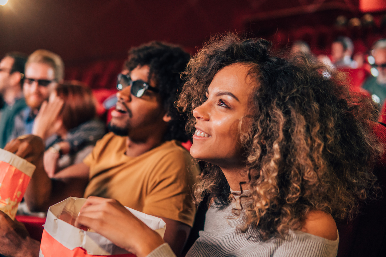Smiling woman watching a movie