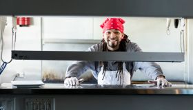 Mixed race man with dreadlocks in commercial kitchen