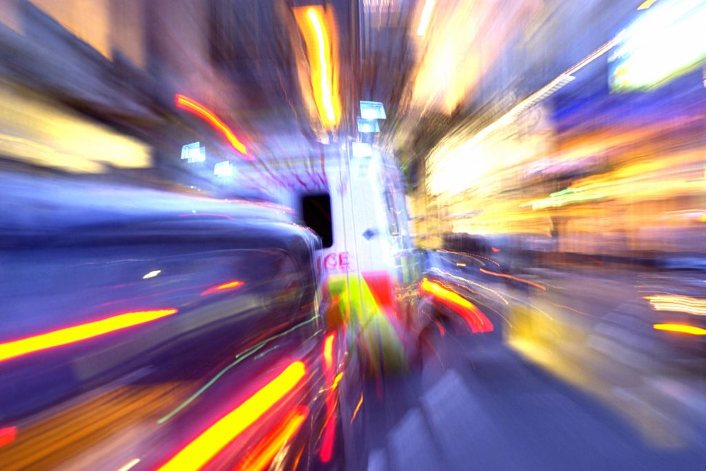 Blurred ambulance in traffic