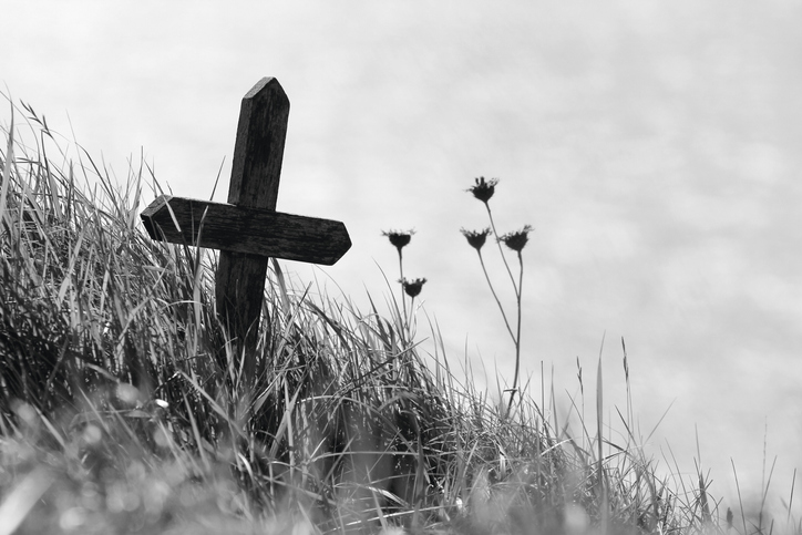 Wooden cross on the edge of a cliff