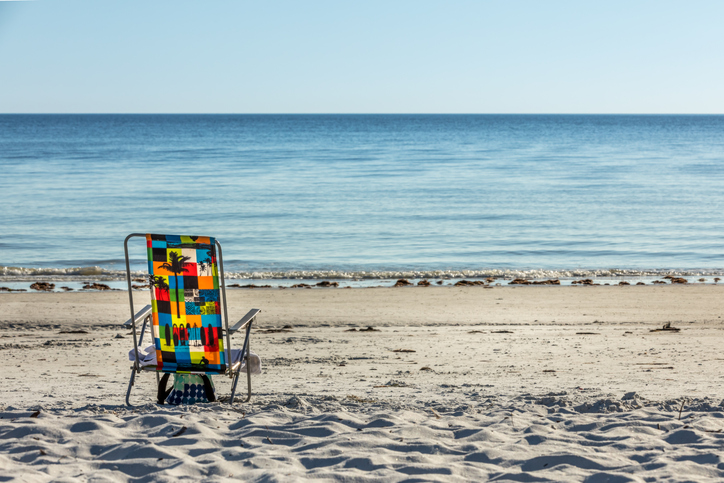 Deck Chair On Beach Against Clear Sky