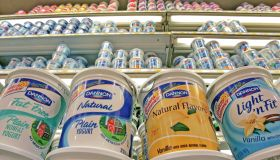 Dannon yogurt waits on a dairy shelve fo