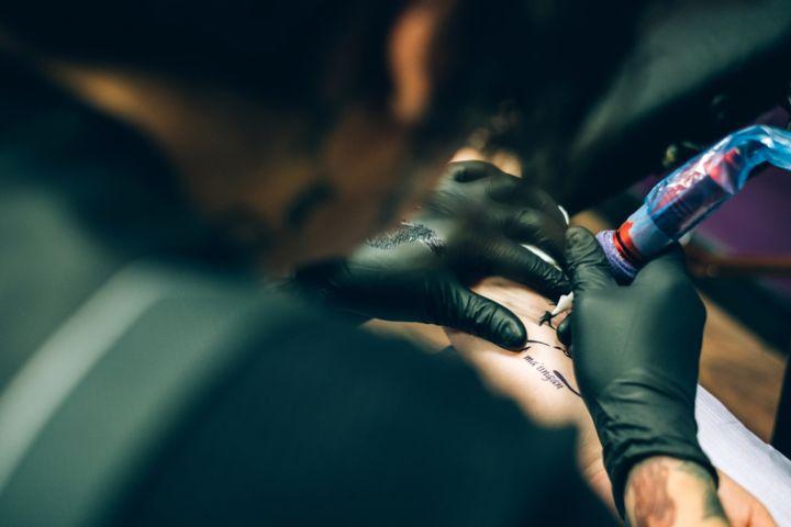 Tattoo artist working in his studio