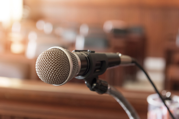 Close-Up Of Microphone In Courtroom