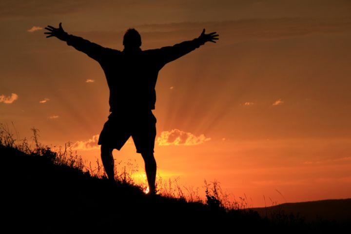 Man celebrates climbing stop mountain