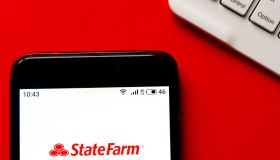 In this photo illustration a State Farm logo seen displayed...